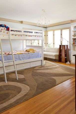 Contemporary Kids Bedroom with Crown molding, Built-in bookshelf, Hardwood floors, Chandelier