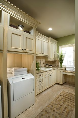 Traditional Laundry Room with sandstone tile floors, Built-in bookshelf