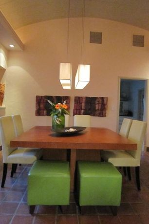 Contemporary Dining Room with Built-in bookshelf, Pendant light, High ceiling, terracotta tile floors, can lights