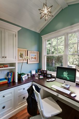 Traditional Home Office with Heirloom Wood Countertops Distressed Black Walnut Plank, Built-in bookshelf, flush light