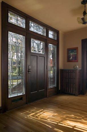 Craftsman Entryway with Maple latte solid real hardwood flooring, Hardwood floors, Chandelier, Crown molding, Transom window