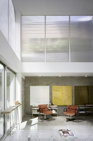 Contemporary Home Office with Concrete floors, French doors, Built-in bookshelf, High ceiling, Knoll Bertoia Side Chair