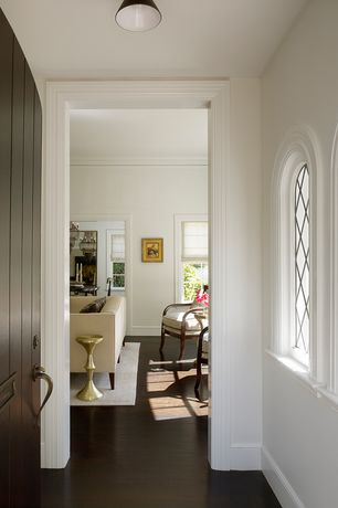 Traditional Hallway with Arched window, Hardwood floors, Pendant light