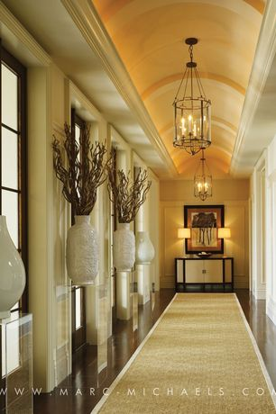 Contemporary Hallway with High ceiling, Chandelier, Glass panel door, Laminate floors, Crown molding