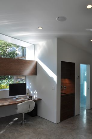 Contemporary Home Office with Concrete floors, Standard height, picture window, specialty door, can lights