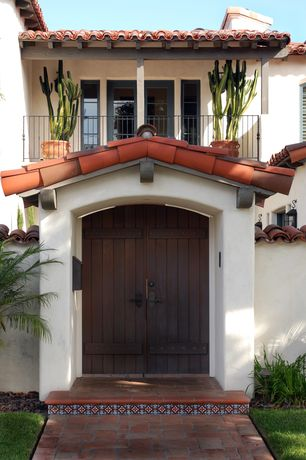 Mediterranean Front Door with Casement, Pathway, French doors, six panel door, Deck Railing, exterior brick floors