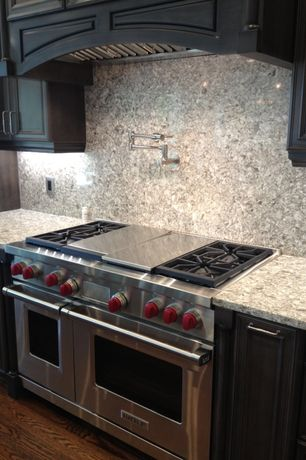 "Contemporary Kitchen with Quartz, Wolf 48"" Dual Fuel Range, Ms international andino white granite, Quartz counters, One-wall"