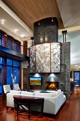 Contemporary Great Room with stone fireplace, Pendant light, Cathedral ceiling, Hardwood floors, Loft