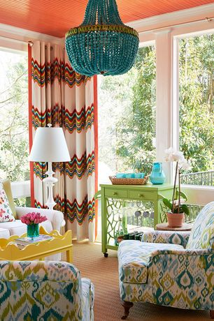 Eclectic Living Room with Crown molding, Carpet, White floor lamp, Turquoise beaded chandelier, Chandelier