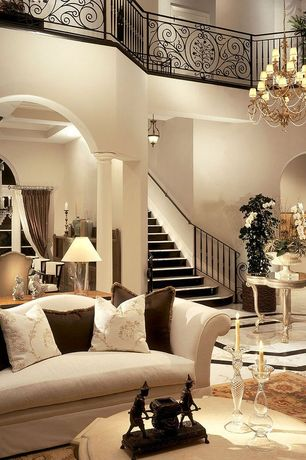 Traditional Living Room with One Kings Lane Camel-Back Settee, simple marble floors, Paint 1, High ceiling, Balcony, Columns