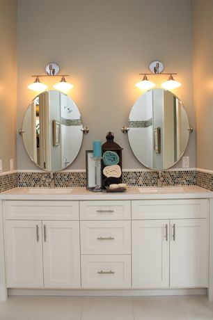 Contemporary Full Bathroom with Undermount sink, Ikea lansa handle, Flat panel cabinets, Corian counters, Penny Tile, Flush