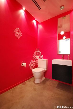 Eclectic Powder Room with Powder room, Stained Concrete In Cola, limestone floors, Wall mounted sink, flush light