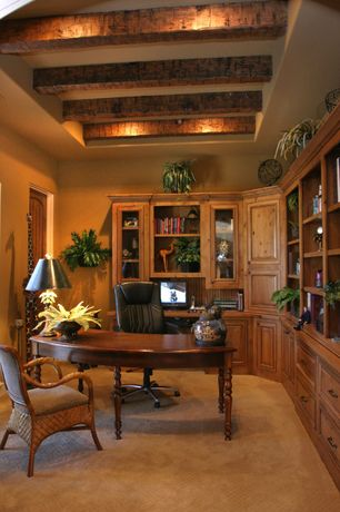 Mediterranean Home Office with Built-in bookshelf, Exposed beam, Carpet, specialty window, Standard height