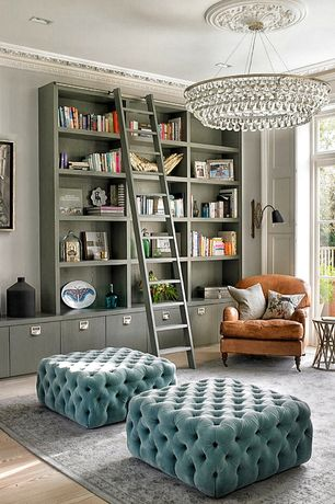 Contemporary Living Room with French doors, Built-in bookshelf, Chandelier, Crown molding, Hardwood floors, Transom window