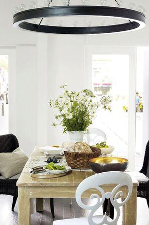 Eclectic Dining Room with Standard height, French doors, Chandelier, Hardwood floors