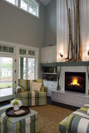 Traditional Living Room with stone fireplace, Wall sconce, Built-in bookshelf, Transom window, Cathedral ceiling