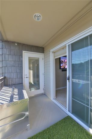 Traditional Porch with sliding glass door, can lights, French doors, Standard height, Concrete floors