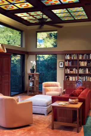 Craftsman Living Room with Carpet, Exposed beam, Ceiling fan, French doors, Built-in bookshelf