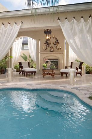 Mediterranean Patio with Freeform swimming pools, exterior stone floors, Ceylon teak lounge chair and ottoman