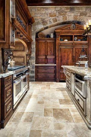 Traditional Kitchen with Kitchen island, Raised panel, Complex granite counters, Granite countertop, Custom hood