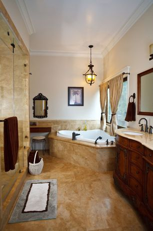 Mediterranean Master Bathroom with Pendant light, MS International Carmella Limestone Tile, Raised panel, Chandelier