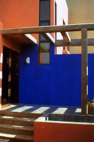 Modern Front Door with exterior tile floors, Pathway, Trellis, Fence