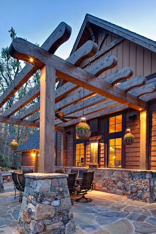 Rustic Patio with picture window, Casement, exterior stone floors, Trellis