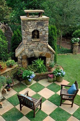 Traditional Patio with Gate, Outdoor seating, exterior tile floors, outdoor pizza oven, exterior concrete tile floors