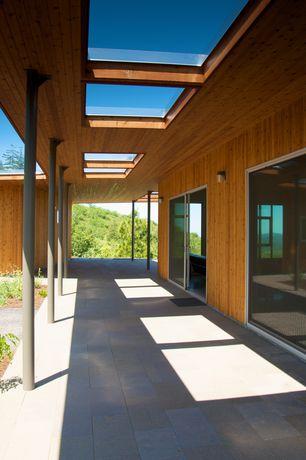Contemporary Porch with Skylight, Wrap around porch, sliding glass door, exterior tile floors, exterior concrete tile floors