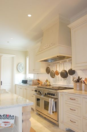 Traditional Kitchen with Complex marble counters, Wolfe - 6 burner + griddle, double oven, Large Ceramic Tile, specialty door