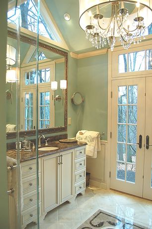 Traditional Master Bathroom with Flat panel cabinets, Paint 1, Transom window, can lights, partial backsplash, Wainscotting
