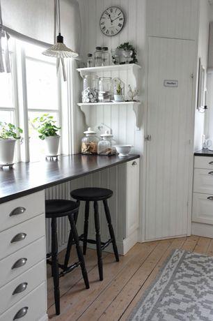 Cottage Kitchen with Ikea Ekby Hemnes Hensvik Wall Shelf White, Hardwood floors, Breakfast bar, specialty door, L-shaped