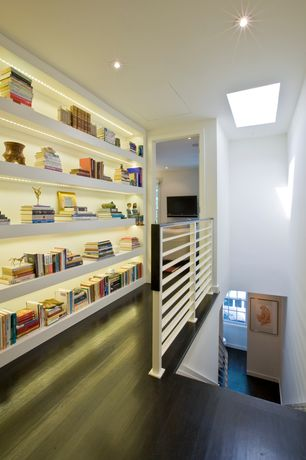 Contemporary Hallway with Wood floors, Large bookcase