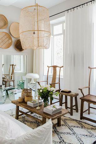 Cottage Living Room with Pendant light, Hardwood floors, Exposed beam