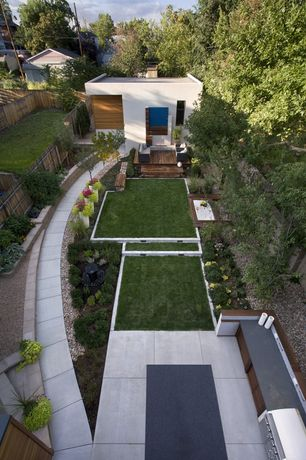 Contemporary Landscape/Yard with Outdoor kitchen, Raised beds, Pathway, exterior tile floors, Fence, Rainbow River Rock, Gate