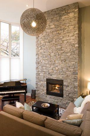 Contemporary Living Room with Pendant light, metal fireplace, Eldorado Stone Mineret Bluffstone, Woven sphere pendant light