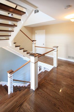Contemporary Staircase with Hardwood floors, flush light