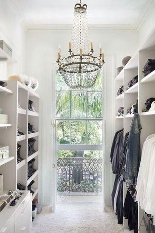 Contemporary Closet with Crown molding, Chandelier, Carpet, Shoe storage, Custom storage, Custom closet