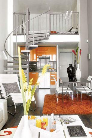 Contemporary Great Room with Loft, Built-in bookshelf, Hardwood floors, specialty door, Chandelier, can lights, High ceiling