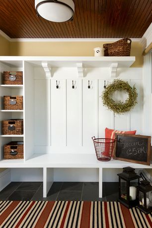 Country Entryway with flush light, Built-in bookshelf, Crown molding, Pental - brazilian black slate, Standard height, Paint