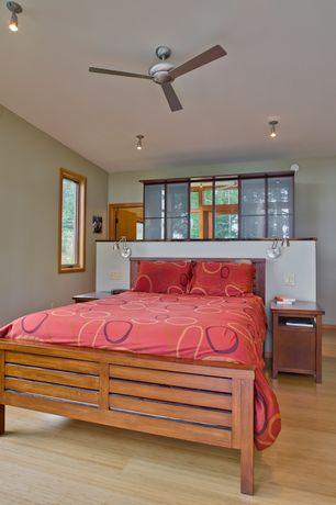 Contemporary Master Bedroom with flush light, Laminate floors, Ceiling fan