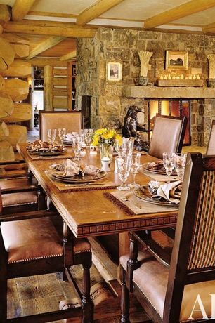 Rustic Dining Room with stone fireplace, Exposed beam, Fireplace, Standard height, Hardwood floors