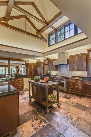 Country Kitchen with slate tile floors, Wall Hood, can lights, picture window, Undermount sink, Flat panel cabinets, Flush