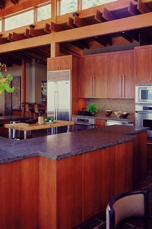 Modern Kitchen with Flush, High ceiling, Ms International Coffee Brown Granite, terracotta tile floors, Kitchen island