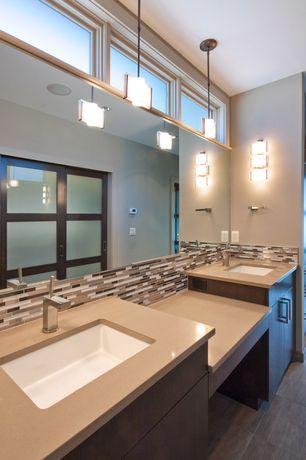 Contemporary Master Bathroom with Flush, Ceramic Tile, full backsplash, Double sink, European Cabinets, can lights
