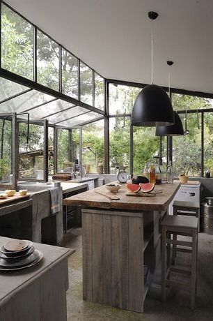 Contemporary Kitchen with U-shaped, Kitchen island, Slate counters, slate tile floors, Pendant light, Wood counters