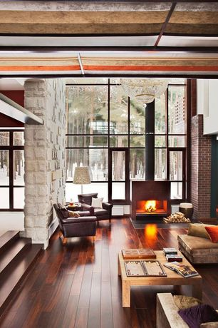 Living Room with Interior stone wall, Floor to ceiling windows, Handcrafted cube low square table, Chandelier, High ceiling