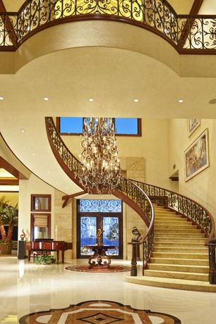 Traditional Staircase with High ceiling, picture window, Chandelier, curved staircase, Paint, stone tile floors
