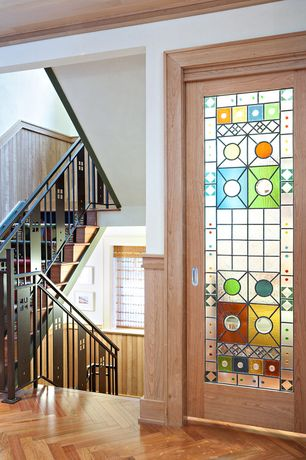 Eclectic Entryway with Crown molding, Glass panel door, Stained glass door, Hardwood floors, Metal staircase