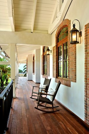 Tropical Porch with Wrap around porch, Arched window
